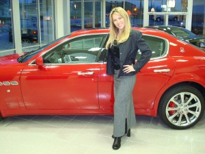 Kae Davis is the Exotic Car Examiner shown here with her favorite red Maserati Quattorporte